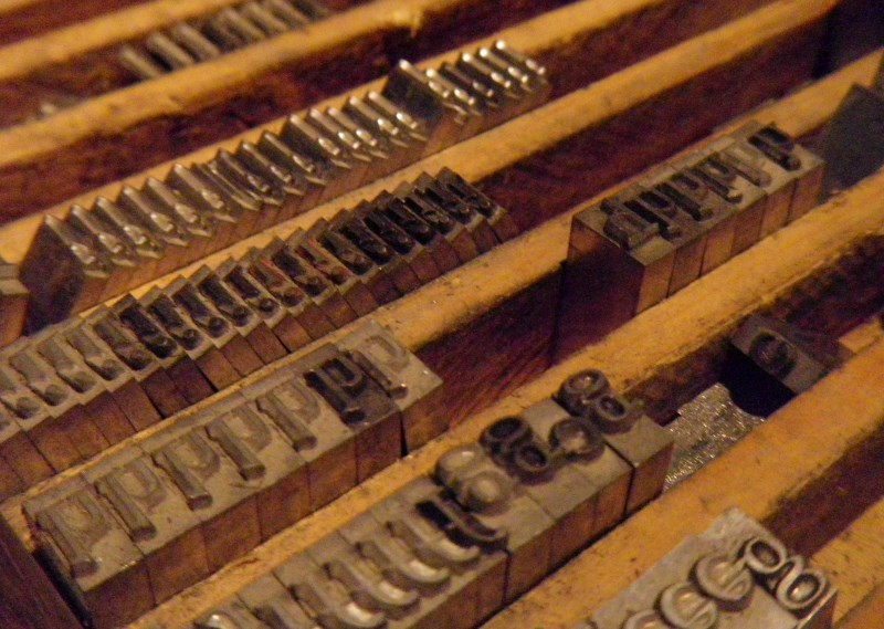 old typefaces in a box ready to be laid out on a print plate