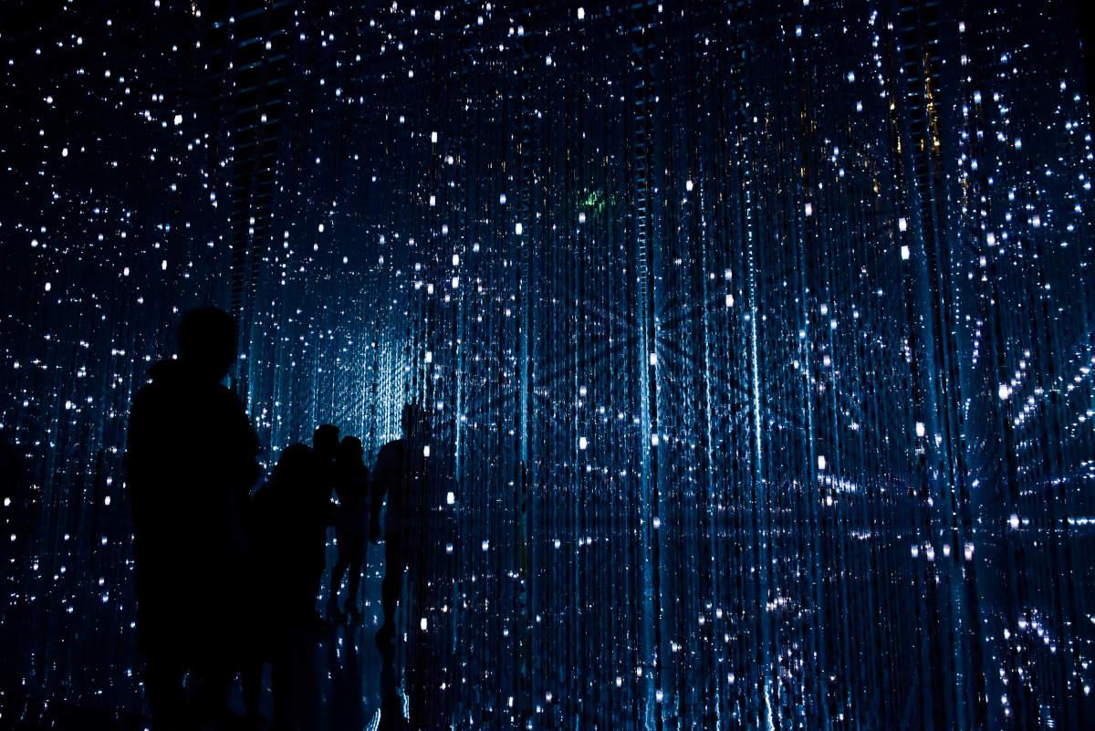 lights form patterns, people inside. by robynne hu